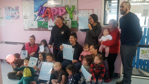 Taihape Childcare Centre staff and children receive water only certificates from WDHB health promoters Narisa Sargison and Karney Herewini.