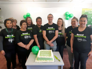 Free bowel screening comes to Whanganui, and project manager Ben McMenamin (centre) leads the cake-cutting team.