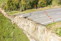 A large landslip in the Parapara Road (State Highway 4) showing the end of the road as it collapses into the earth