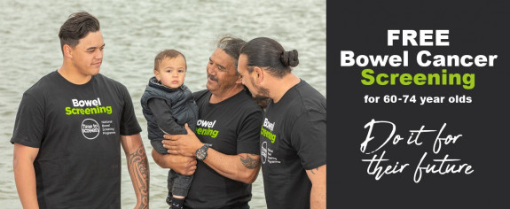 Four Maori males of various ages gather on the river front